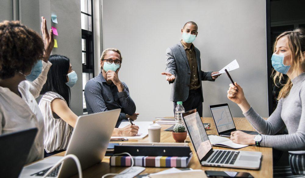 GBM Business people wearing masks in coronavirus meeting, the new no